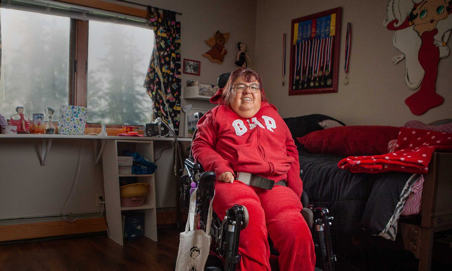 woman in wheelchair in room