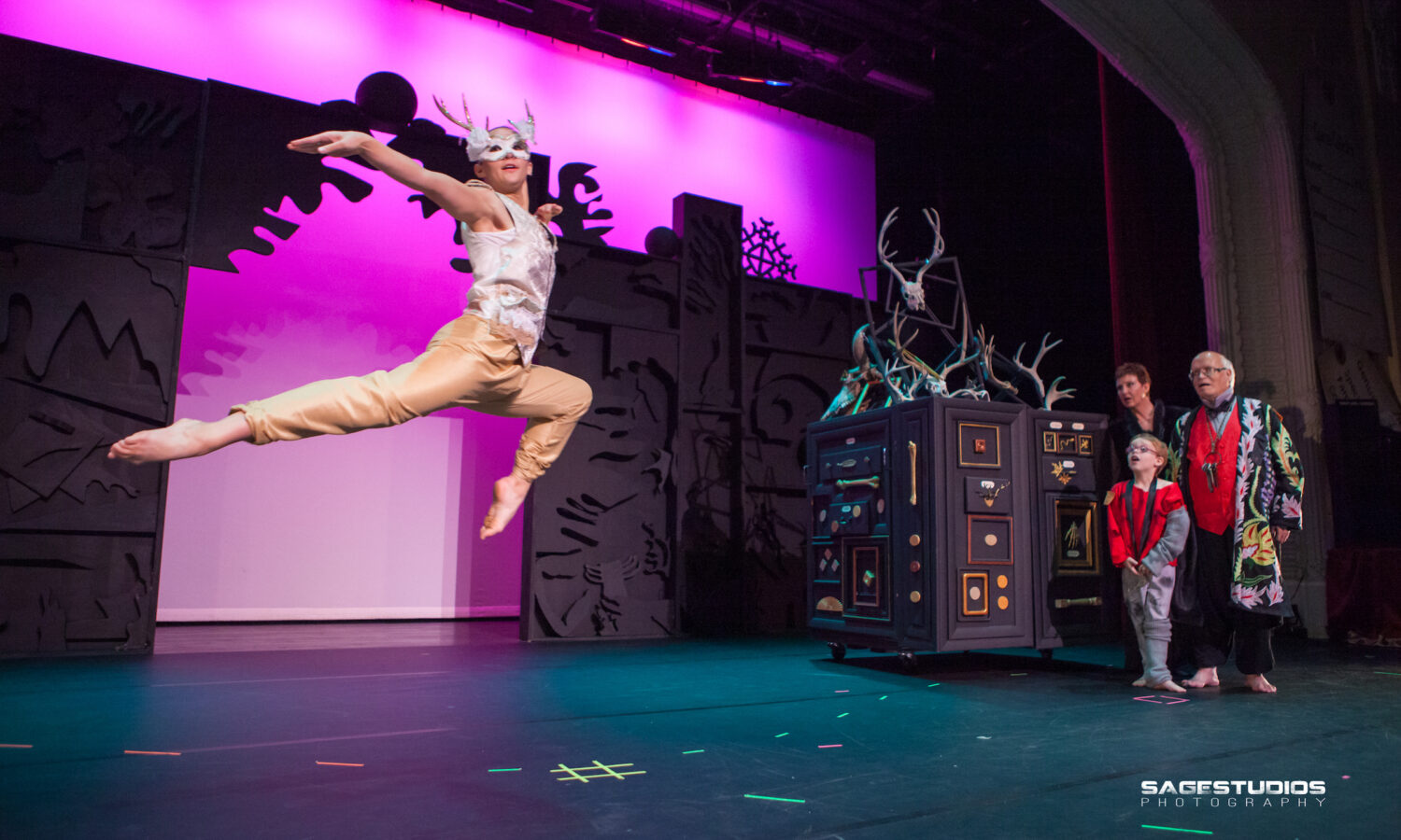 man jumping during theater performance