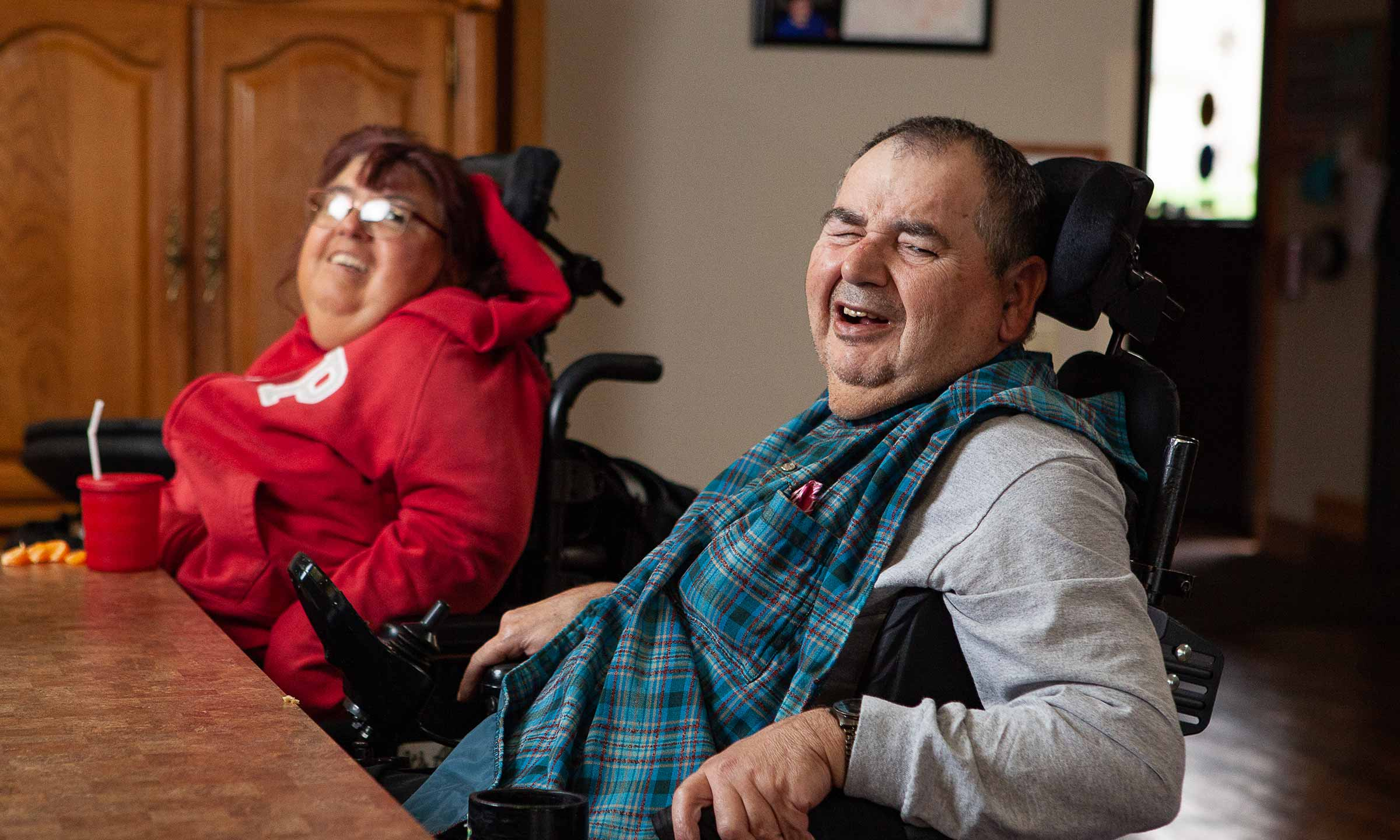 a man and woman in wheelchair