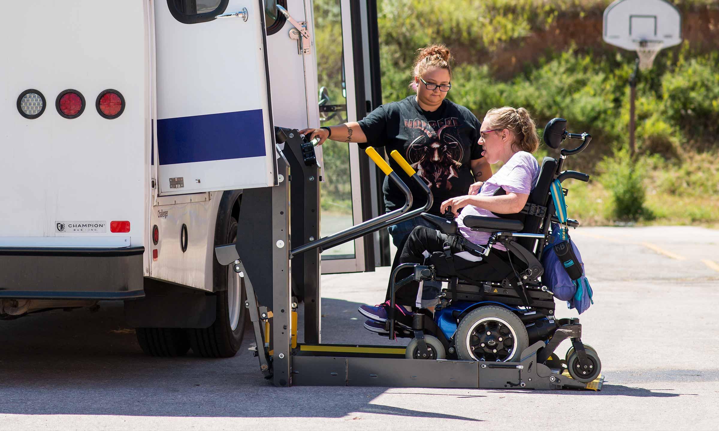woman in wheelchair being loaded into van