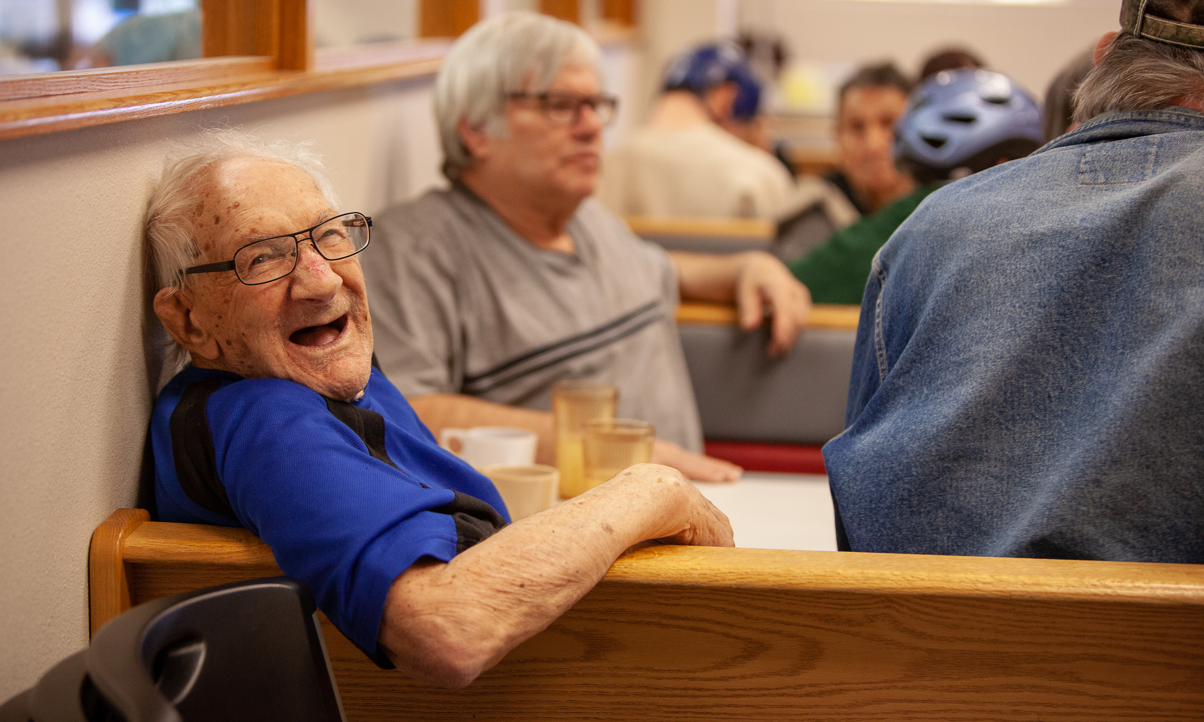 man at a table laughing