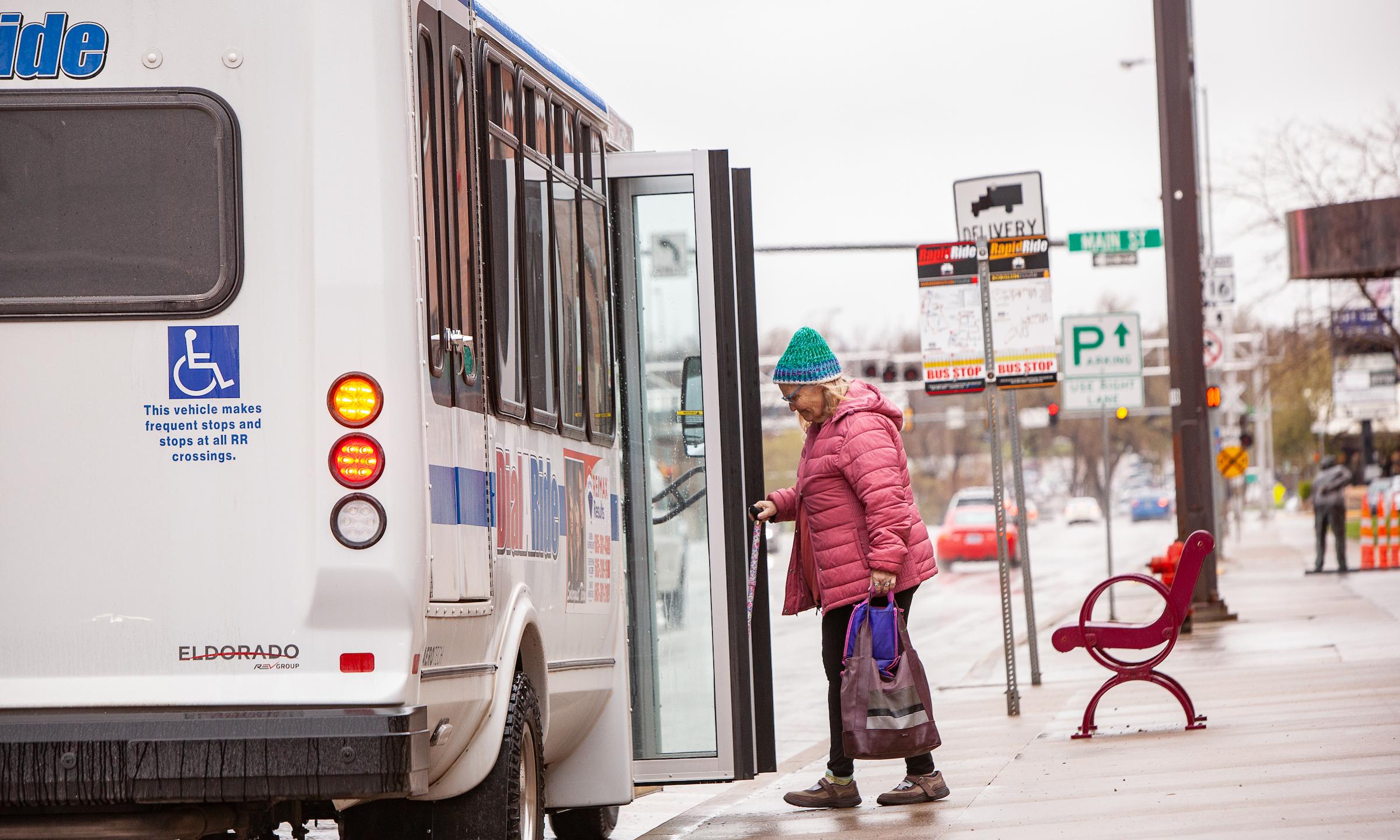 woman boarding public transportation bus